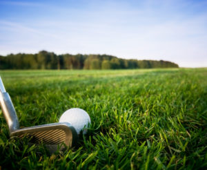 Golf club and ball. Preparing to shot
