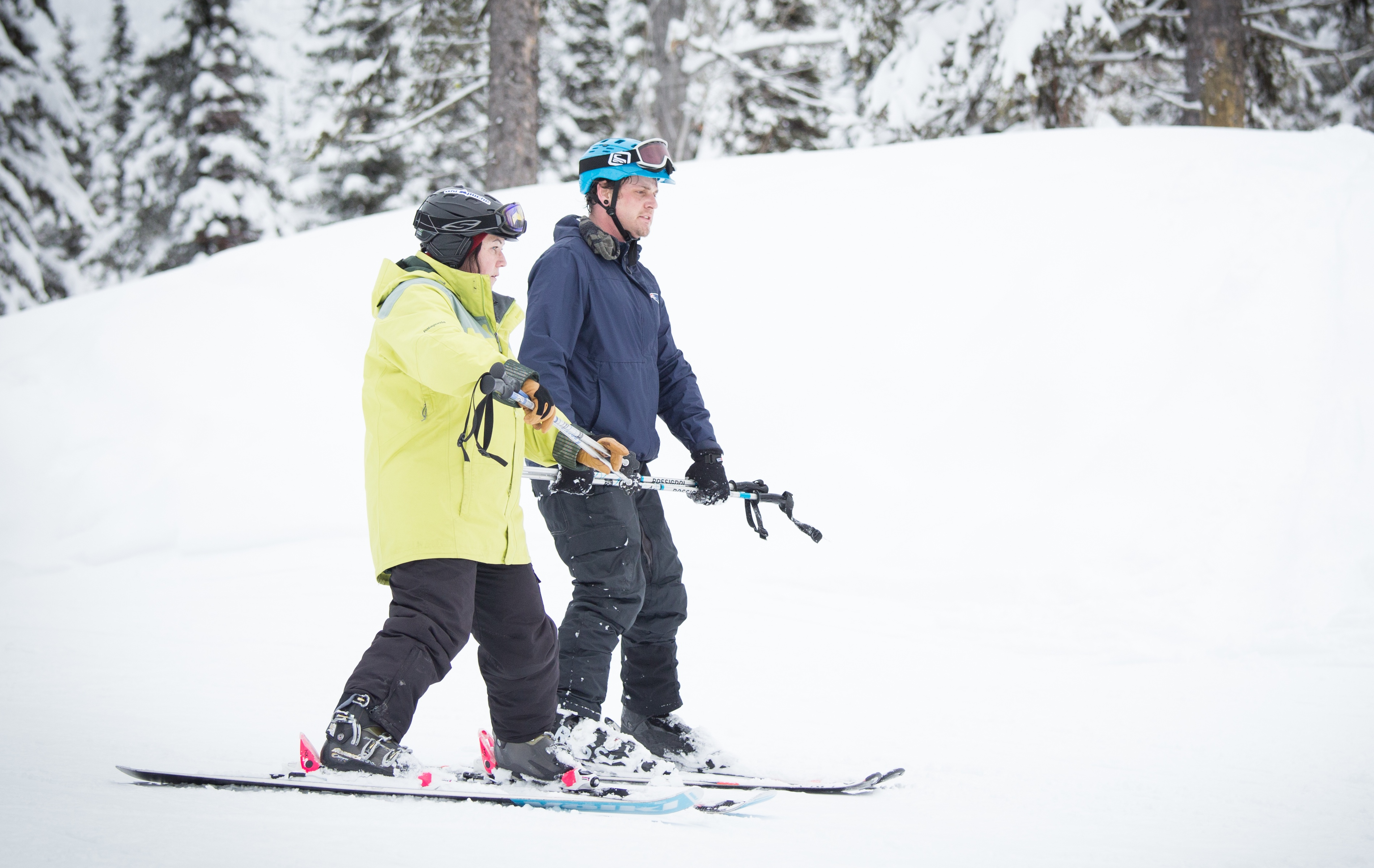 A Dream volunteer skiing with a participant
